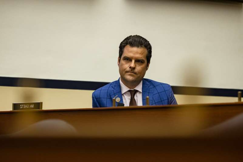 Matt Gaetz sitting on a table: Representative Matt Gaetz (R-FL) is shown above during a House Armed Services Subcommittee hearing with members of the Fort Hood Independent Review Committee on Capitol Hill on December 9, 2020 in Washington, DC.