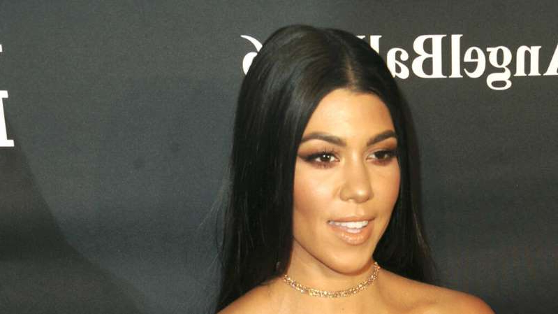 Kourtney Kardashian smiling for the camera