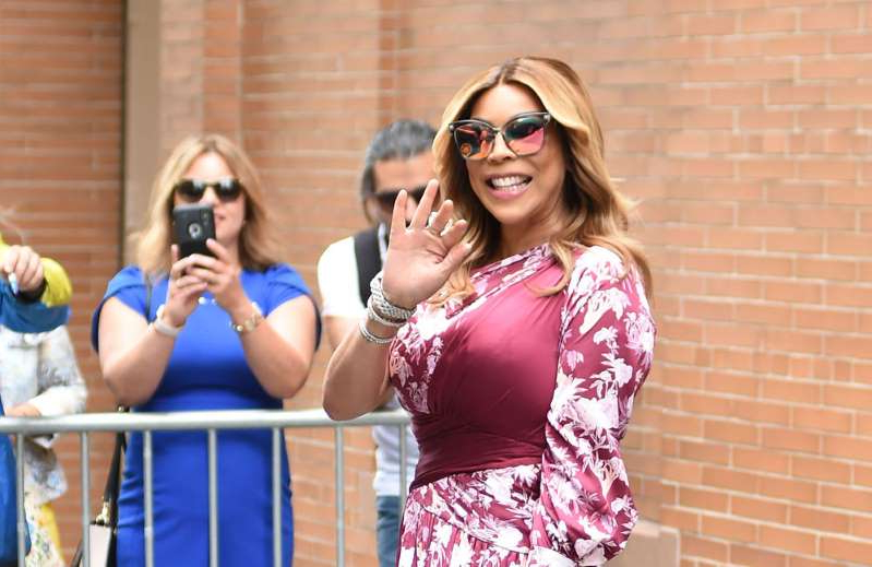 a woman talking on a cell phone: Wendy Williams