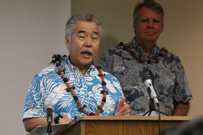 Bruce Anderson, David Ige are posing for a picture: Gov. David Ige asks tourists to postpone their visit to Hawaii.