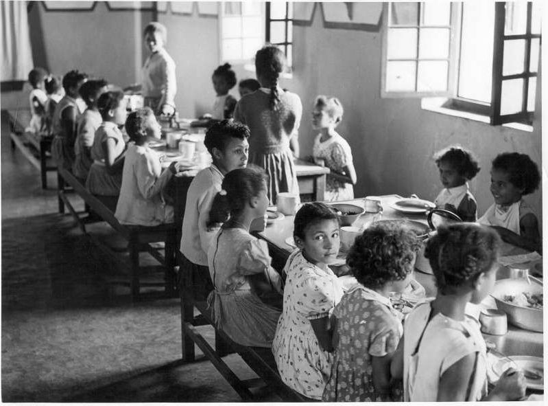 a group of people sitting in a room: An archive photo showing children at Save, a key institution to which stolen mixed-race children were taken [Courtesy of metisbe.squarespace.com]