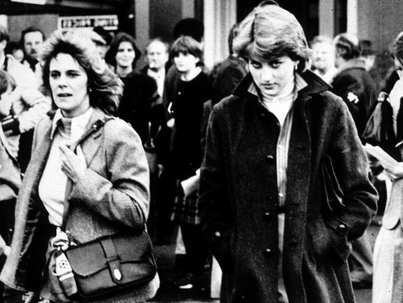 a group of people posing for a photo: Lady Diana Spencer and Camilla Parker-Bowles pictured together in 1980. Express Newspapers/Archive Photos via Getty Images