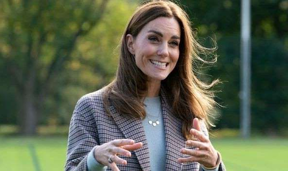 a person smiling in a park: kate middleton news duchess cambridge royal family