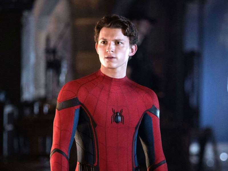 Tom Holland standing in front of a building: Tom Holland as Spider-Man in 'Spider-Man: Far From Home.'