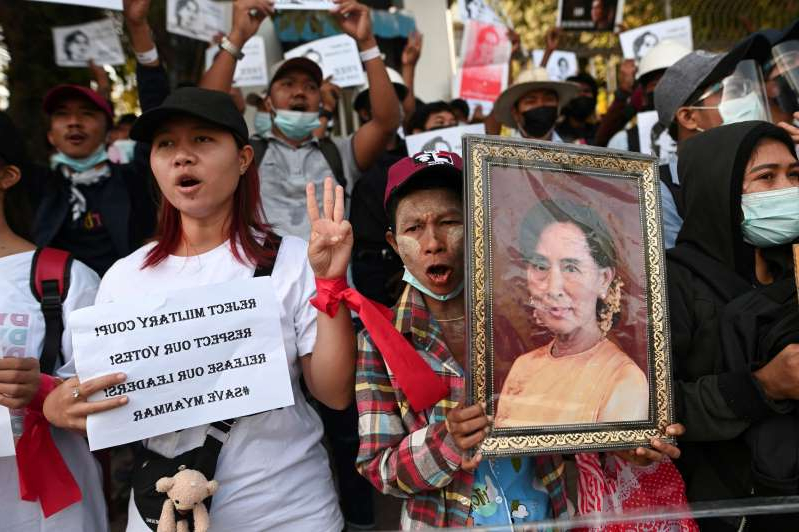 Aung San Suu Kyi et al. posing for the camera: FILE PHOTO: Rally against military coup in Yangon