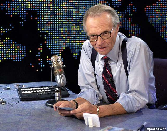 Larry King sitting at a table using a laptop: Legendary broadcaster Larry King's cause of death has been confirmed as sepsis, likely triggered by a bacterial infection just weeks after he recovered from COVID-19