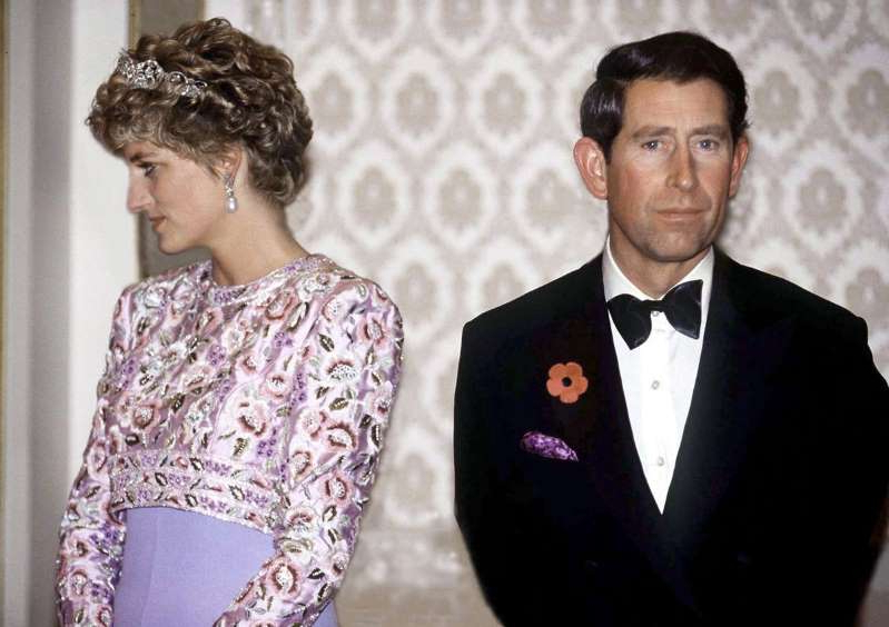 Prince Charles standing in front of a mirror posing for the camera: Charles And Diana Unhappy