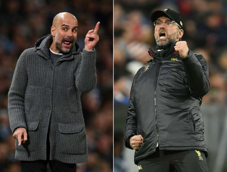 Pep Guardiola talking on a cell phone: Manchester City's Pep Guardiola (right)expressed his sympathy with Jurgen Klopp (left)after criticism of the Liverpool manager