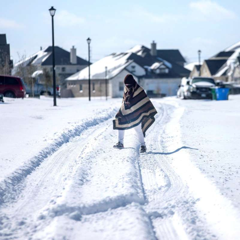 a person riding a snowboard down a snow covered slope: Deep Freeze Power Crisis In Texas Is Expanding