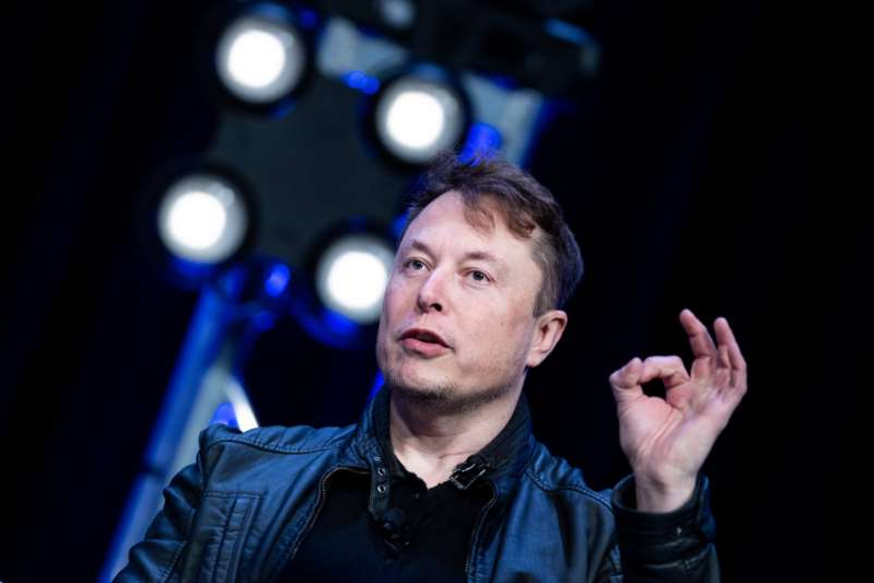 Elon Musk standing in front of a stage: Elon Musk speaking at a satellite conference in March 2020. The Tesla CEO explained his stance on bitcoin in a Twitter exchange.