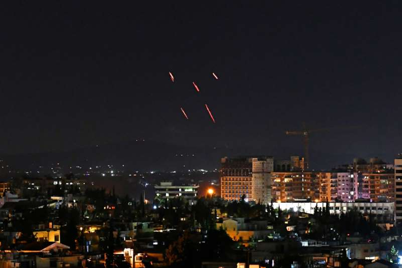 fireworks over a city at night: Syrian air defenses respond to Israeli missiles targeting south of the capital Damascus, on July 20, 2020. Israel has repeatedly struck targets said to be associated with Iran and its allied militias, as well as Syrian anti-air batteries operating in territory held by the government led by President Bashar al-Assad.