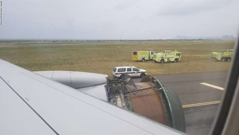 a car parked on the side of the road: In 2018, a Boeing 777 lost its right engine cover over the Pacific Ocean en route to Honolulu. The plane safely landed, but passengers were terrified.