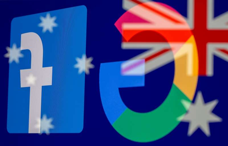 a close up of a sign: FILE PHOTO: Google and Facebook logos and Australian flag are displayed in this illustration taken