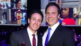 Andrew Cuomo, Chris Cuomo are posing for a picture: New York Governor Andrew Cuomo and Chris Cuomo attend The Robin Hood Foundation's 2015 Benefit at Jacob Javitz Center on May 12, 2015 in New York City.
