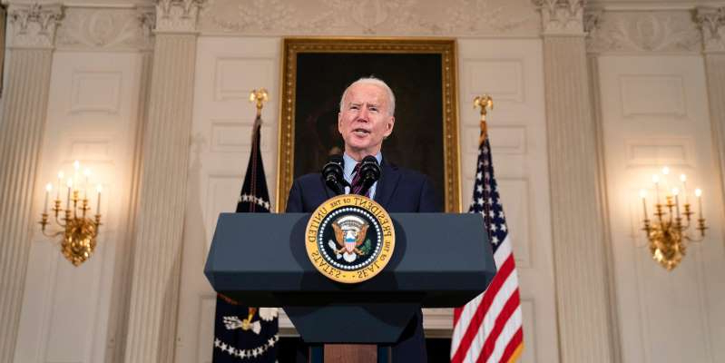 Joe Biden standing in front of a mirror posing for the camera: President Joe Biden speaks in the State Dining Room at the White House on February 5, 2021.