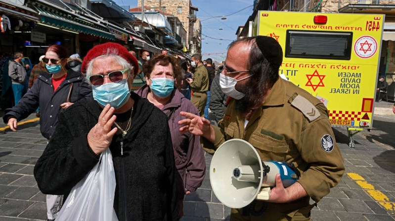 a group of people wearing costumes: A vaccination campaign in Jerusalem, Israel, on February 22, 2021.