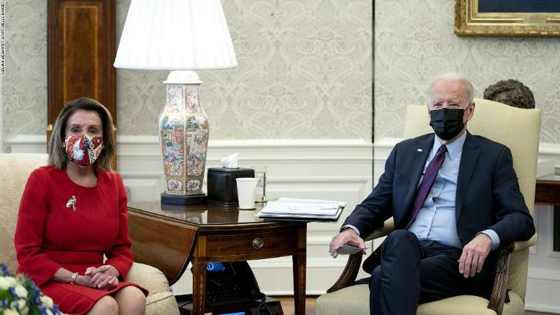 a man and a woman sitting on a bench: WASHINGTON, DC - FEBRUARY 05: U.S. President Joe Biden (L) meets with House Democratic leaders, including Speaker of the House Nancy Pelosi (D-CA) (R), and committee chairs to discuss the coronavirus relief legislation in the Oval Office at the White House February 5, 2021 in Washington, DC. In an effort to generate bipartisan support for his legislation, Biden met earlier in the week with Republican and Democratic senators to discuss his administration's $1.9 trillion COVID-19 relief plan. (Photo by Stefani Reynolds-Pool/Getty Images)
