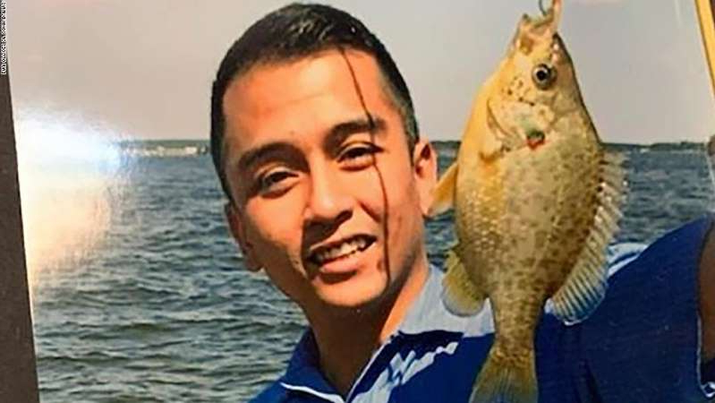 a man holding a fish in the water: Angelo Quinto, 30, died days after police officers knelt on his neck while responding to a mental health call, attorneys for his family said.