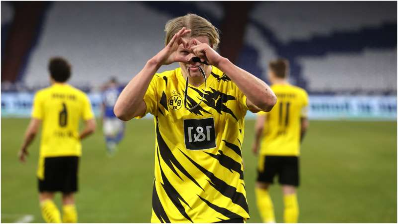 a person holding a football ball: Erling Haaland can be expected to have his pick of the big clubs when he leaves Dortmund.