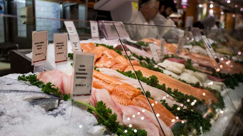a plate of food on a table: Display of fresh fish for sale at local market in Grand Central Station (Getty Images)