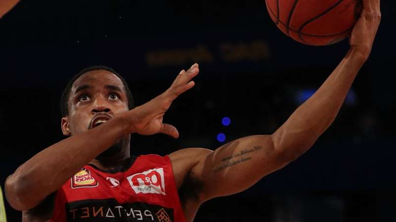 Bryce Cotton holding his hands up: Bryce Cotton scored 30 points to lead the Wildcats to a 113-106 NBL Cup win over the Sydney Kings.