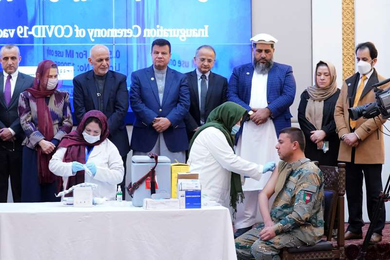 Nasrin Oryakhil, Ashraf Ghani, Amrullah Saleh posing for the camera: Members of Afghan security forces receive the first dose of AstraZeneca's COVID-19 vaccine from India, in Kabul
