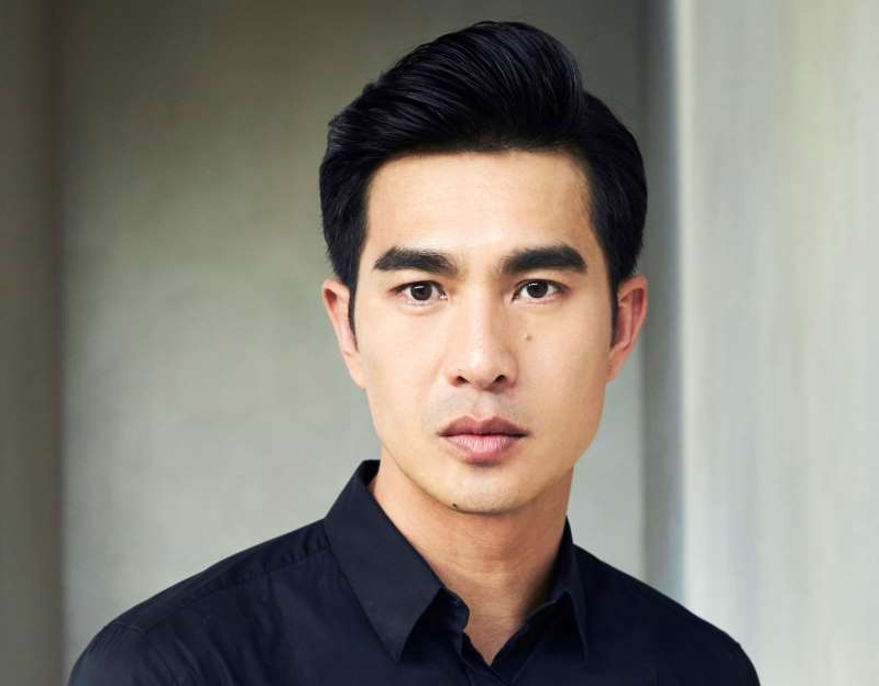 Pierre Png posing for the camera