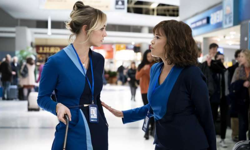 a person standing next to a bag of luggage: Rosie Perez and Kaley Cuoco in The Flight Attendant. Photograph: Phil Caruso/AP