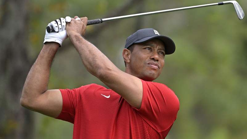 Tiger Woods holding a baseball bat: Woods was recovering from his fifth back surgery. (AP Photo/Phelan M. Ebenhack, File)