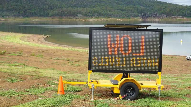 a sign in front of a lake: Lake Moogerah was at 13.3 per cent capacity on February 24. (Supplied: Seqwater)