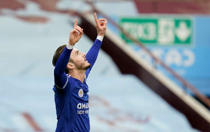 a man jumping in the air: FILE PHOTO: Premier League - Aston Villa v Leicester City