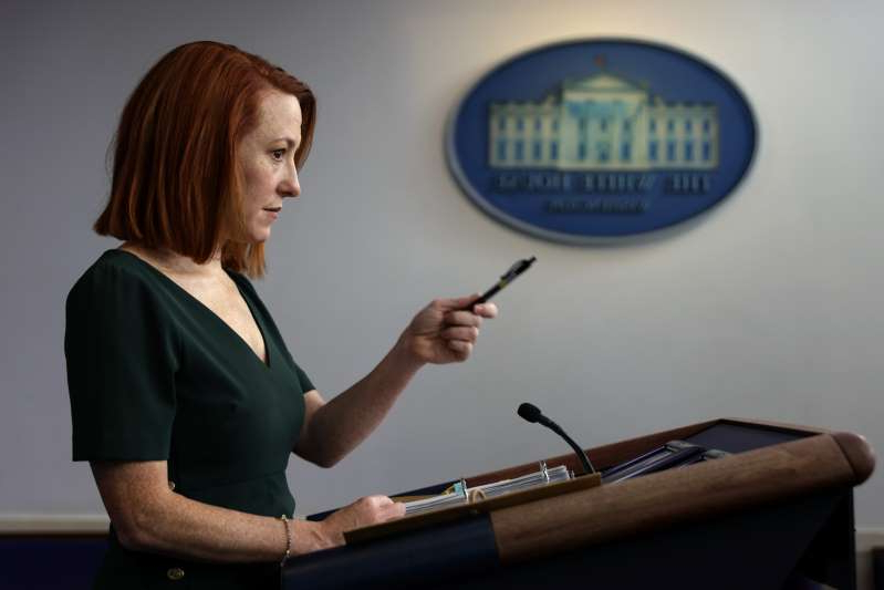 a person holding a phone: White House Press Secretary Jen Psaki told Meghan McCain in an interview on