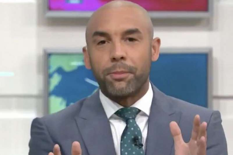 Alex Beresford wearing a suit and tie: Alex Beresford hit out at Prince Harry on Friday's Good Morning Britain