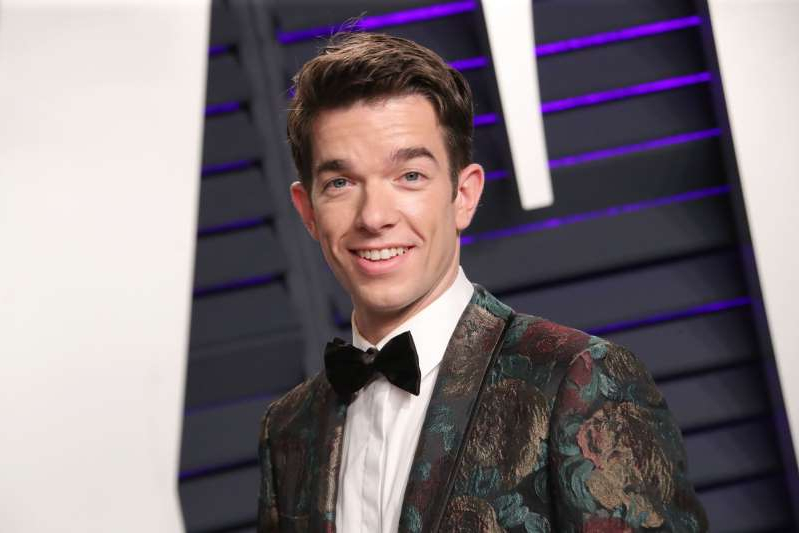 John Mulaney wearing a suit and tie: John Mulaney, Vanity Fair Oscar Party, 2019
