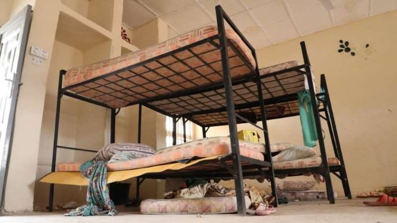 a bedroom with a bed and a chair in a room: The girls were reportedly taken to a nearby forest