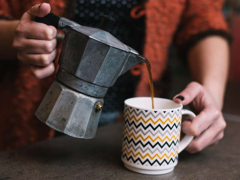 a hand holding a cup of coffee: There are some easy ways to make better homemade coffee. viki2win/Shutterstock