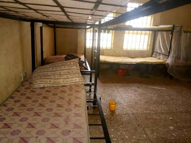 a large bed in a room: Dormitories at the Government Girls Science Secondary School in Jangebe are empty