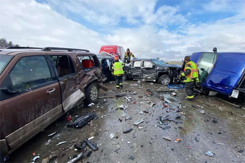 a car parked in a parking lot: Emergency workers respond to a crash near Billings, Mont., on Feb. 27, 2021. (Montana Highway Patrol via Twitter)