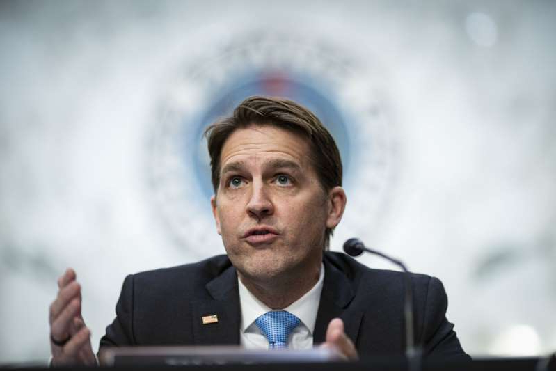 Ben Sasse wearing a suit and tie: Sen. Ben Sasse is shown above speaking during a confirmation hearing on February 22, 2021 in Washington, DC. He has since been rebuked by the Nebraska GOP.
