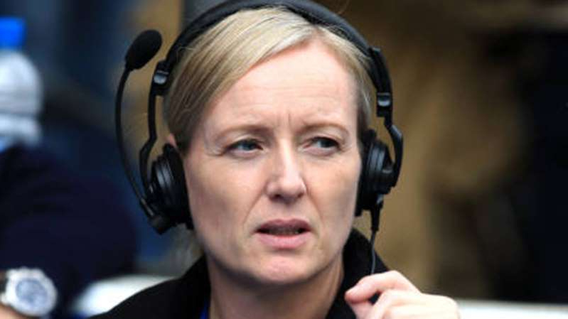 Sonja McLaughlan wearing a headset and smiling at the camera: The BBC's Sonja McLaughlan.