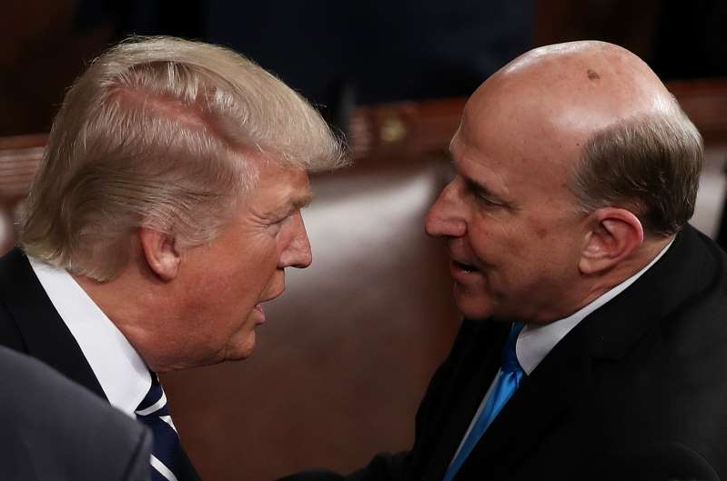 a man wearing a suit and tie: U.S. President Donald Trump talks with Rep. Louie Gohmert (T-TX) at the joint session of the U.S. Congress on February 28, 2017 in the House chamber of the U.S. Capitol in Washington, DC. Trump's first address to Congress focused on national security, tax and regulatory reform, the economy, and healthcare. (