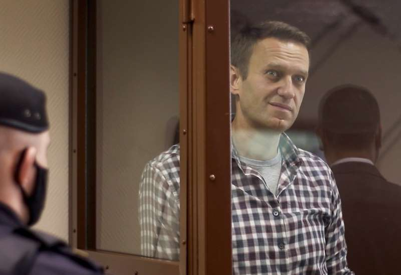 Alexei Navalny standing in front of a mirror posing for the camera: Navalny fell ill in Siberia last August and was flown to Germany, which says it found evidence he had been poisoned by a banned nerve agent [Press Service of Moscow City Court/Reuters]