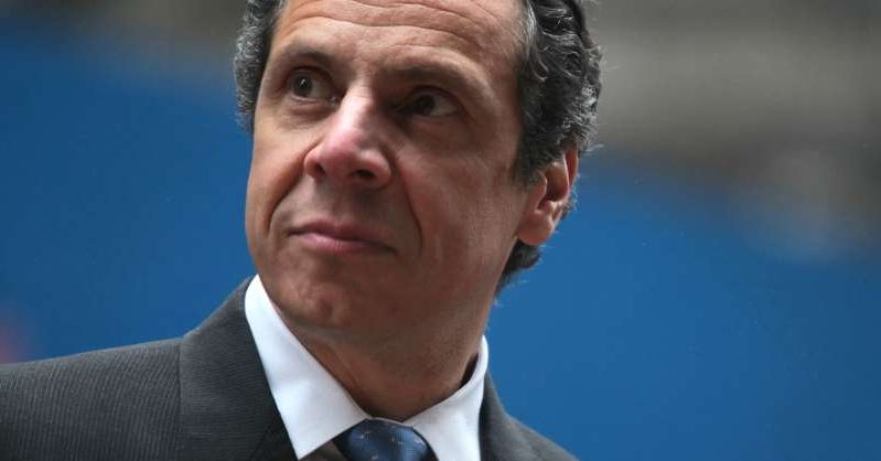 Andrew Cuomo wearing a suit and tie smiling at the camera: New York Attorney General Andrew Cuomo