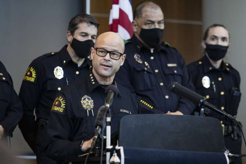 a man wearing a military uniform: Chief Eddie García, center, speaks with media during a press conference regarding the arrest and capital murder charges against Officer Bryan Riser at the Dallas Police Department headquarters on Thursday, March 4, 2021, in Dallas. Riser was arrested Thursday on two counts of capital murder in two unconnected 2017 killings that weren't related to his police work, authorities said. Riser, a 13-year veteran of the force, was taken into custody Thursday morning and brought to the Dallas County Jail for processing, according to a statement from the police department.