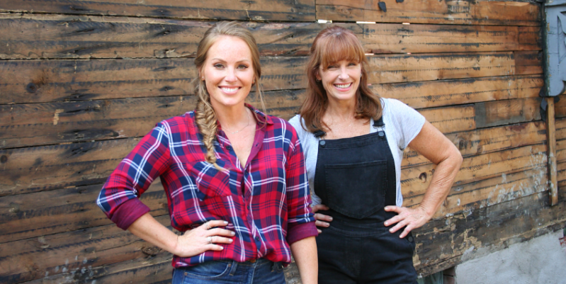 a person standing in front of a fence: HGTV's'Good Bones' stars mother-daughter duo Karen E Laine and Mina Starsiak Hawk as they remodel rundown homes in Indianapolis, Indiana.