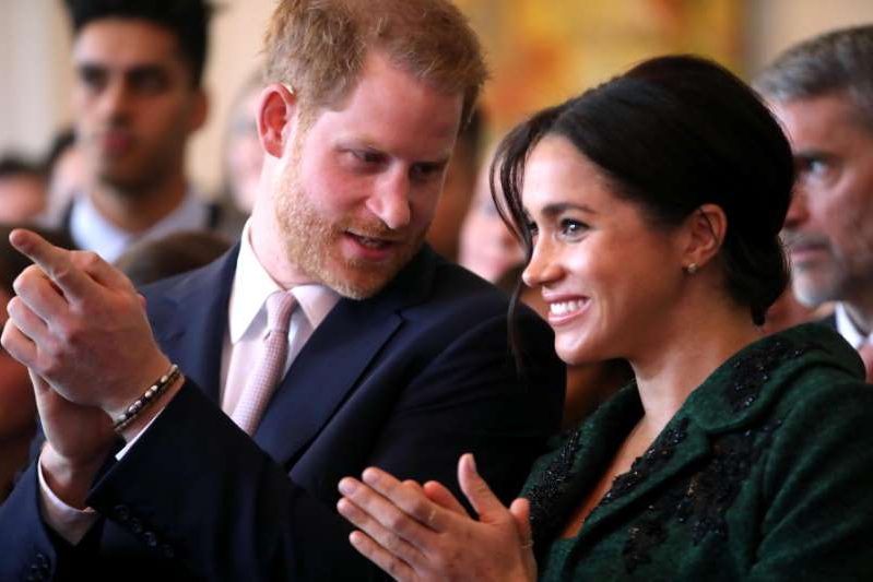 Meghan Markle, Prince Harry that are talking to each other: Meghan Markle and Prince Harry during a musical performance as they attend a Commonwealth Day Youth Event at Canada House on March 11, 2019 in London, England.