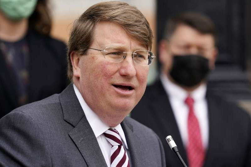 Tate Reeves wearing a suit and tie