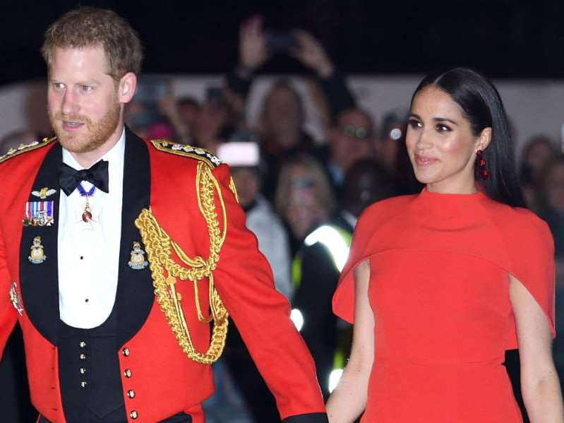 Meghan Markle, Prince Harry are posing for a picture: The Duke and Duchess of Sussex at the Mountbatten Festival of Music at the Royal Albert Hall in March, 2020.