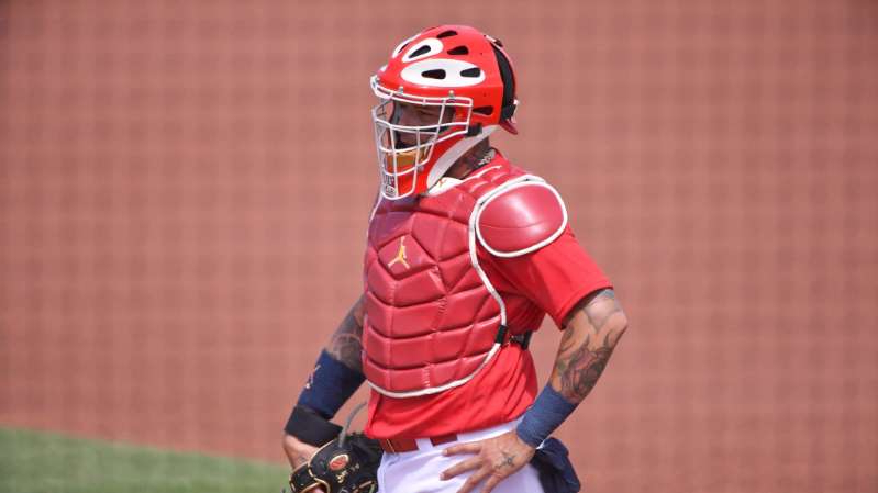 a baseball player is getting ready to hit the ball: Yadier Molina, Washington Nationals v St. Louis Cardinals | Mark Brown/Getty Images