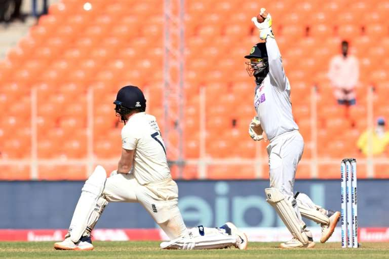a baseball player taking a swing at a ball: Man of the moment: Rishabh Pant celebrates after the dismissal of Dom Bess in the fourth and final Test